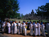 Nuns Receiving Alms at the Bayon Temple Festival at Angkor Thom, Angkor, Siem Reap, Cambodia Photographic Print by Anders Blomqvist