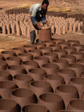 Man Drying Clay Pots and Tiles, Lijiang, China Photographic Print by Keren Su