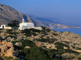 Small Whitewashed Church in Rocky Coastal Area Near Village of Loutro, Loutro, Greece Photographic Print by Trevor Creighton