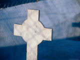 Gravestone Cross Casting Shadow on Wall of Church Near Village of Loutro, Loutro, Greece Photographic Print by Trevor Creighton