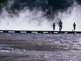 Tourists Silhouetted Against Steam from Grand Prismatic Spring, Yellowstone National Park, USA Photographic Print by John Elk III