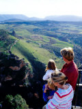 Family Looking at Countryside from Lookout, Ronda, Spain Photographic Print by Philip & Karen Smith