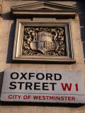 Coat of Arms and Street Sign on Wall, Oxford St, London, United Kingdom Photographic Print by Charlotte Hindle