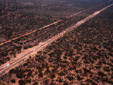 Trans-Continental Railway Line Crossing Outback, Australia Photographic Print by Diana Mayfield
