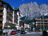 Apartment Buildings with Cliffs of Cristallo Group Behind, Cortina, Veneto, Italy Photographic Print by Grant Dixon