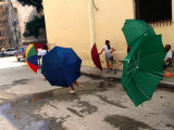 Girls with Umbrellas in Street of Old Havana, Havana, Cuba Photographic Print by Rick Gerharter