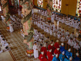 Priests and Other Worshipers Praying in Caodai Great Temple, Tay Ninh, Vietnam Photographic Print by Pershouse Craig