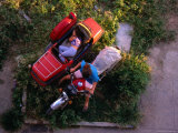 Overhead View of Woman Sleeping in Sidecar of Motorcycle, Havana, Cuba Photographic Print by Rick Gerharter