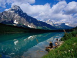 Couple Sitting on Edge of Waterfowl Lake, Banff National Park, Canada Photographic Print by Philip & Karen Smith