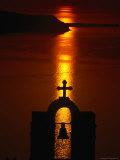 Church Belltower Silhouetted at Sunset, Greece Fotografisk tryk af Izzet Keribar