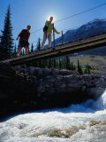 Hikers Crossing Bridge Over Fast-Flowing River, Yoho National Park, Canada Photographic Print by Philip & Karen Smith