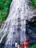 Family Looking Up at Jungle Waterfall, French Polynesia Photographic Print by Philip & Karen Smith