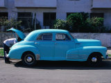 Man Looking in Boot of a Blue 1948 Chevrolet, Vedado, Cuba Photographic Print by Rick Gerharter