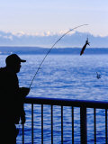 Fisherman on Waterfront Park, Seattle, Washington, USA Photographic Print by Lawrence Worcester