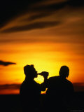 Two People Silhouetted Against Sunset in Beer Garden of Waterski Club, Darwin, Australia Photographic Print by Will Salter