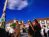 Tibetans Walking Around Jokhang Temple Spinning Prayer Wheels in Barkhor Square, Lhasa, China Photographic Print by Anthony Plummer