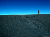 Man Walking on Rim of Irazu Volcano Crater, Against Blue Sky, Cartago, Costa Rica Photographic Print by Eric Wheater