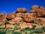 Woman Looking at Devil's Marbles Boulders, Devil's Marbles Conservation Reserve, Australia Photographic Print by Manfred Gottschalk