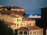 Elba Ferry Passing Old Section of Town, Piombino, Italy Photographic Print by Damien Simonis