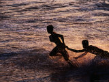 Boys Playing Ball on Galle Face Beach at Sunset, Colombo, Sri Lanka Photographic Print by Richard I'Anson