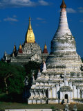 Golden Spire of Ananda Pahto Behind a White-Washed Stupa on Plains of Bagan, Mandalay, Myanmar Photographic Print by Anders Blomqvist