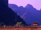 West Bank of Nam Song River, Vang Vieng, Laos Photographic Print by John Banagan