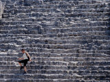 Woman Walking Down Steep Stairs of the Pyramid in El Mundo Perdido Complex, Tikal, Guatemala Photographic Print by Ryan Fox
