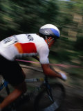 Mountain Bike Racer, Cycling Down Slope, Australia Photographic Print by Trevor Creighton