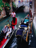 Gondola with Passengers Gliding Through Narrow Canal, Venice, Italy Photographic Print by Glenn Beanland