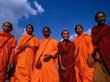 Monks at Angkor Wat, Angkor, Cambodia Fotodruck von Michael Coyne