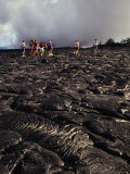 Group of Tourists Crossing Lava Fields, Hawaii Volcanoes National Park, Hawaii (Big Island), USA Photographic Print by Shannon Nace
