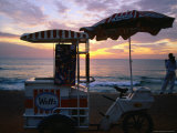 Ice Cream Vendor at the Beach on Galle Road at Sunset, Colombo, Western, Sri Lanka Photographic Print by Christian Aslund