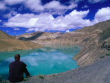Traveller Sitting Overlooking the Turquoise Yamdrok Tso (Lake) on the Friendship Highway, China Photographic Print by Anthony Plummer