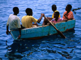 Boys Rowing Boat, Soufriere, Dominica Fotografie-Druck von Michael Lawrence