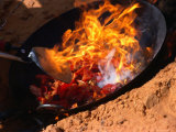 Cooking in Wok Over Camp Fire Simpson Desert, Australia Photographic Print by John Hay