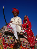 Young Children on Decorated Elephant During Annual Desert Festival of Jaisalmer, India Photographic Print by Jane Sweeney