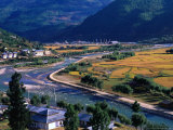 Aerial View of River Running Through Paro Valley and Airport, Paro Town, Bhutan Photographic Print by Nicholas Reuss