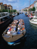 Boat Touring Canals of Christianshavn, Copenhagen, Denmark Photographic Print by John Borthwick