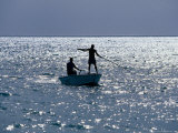 Two Men Fishing from Small Boat, Coconut Island, Australia Photographic Print by Oliver Strewe