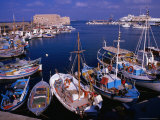 Fishing Boats in Harbour with Venetian Fortress Herakleion in Distance, Greece Photographie par Wayne Walton