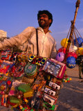 Toy Vendor and Merchandise on Chowpetty Beach, Mumbai, Maharashtra, India Photographic Print by Dallas Stribley
