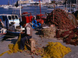 Fisherman Mending His Nets on Waterfront in Herakleion, Greece Photographic Print by Wayne Walton