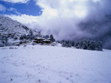 Laya Village Covered in Snow, Laya, Bhutan Photographic Print by Nicholas Reuss