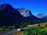 Car Driving on Road with Mountain Range Glacier National Park, Montana, USA Photographic Print by Rob Blakers