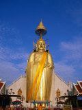 Golden Buddha Statue at Wat Intharawihan, Bangkok, Thailand Photographic Print by Paul Beinssen
