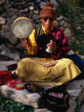 Monk Performing Ritual in Chingdrol Chiling Park, Using Hand-Held Drum and Bell, Lhasa, China Photographic Print by Pershouse Craig