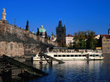Passenger Ferry Cruising Up Vltava River Near Charles Bridge, Prague, Czech Republic Photographic Print by Richard Nebesky