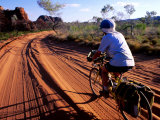 Cyclist on Outback Road, Purnululu National Park, Australia Photographic Print by Trevor Creighton