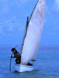 A Fisherman Using a Piece of Wood to Help Propel His Sail-Boat, Rodrigues Island, Africa Photographic Print by Olivier Cirendini