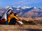 Couple Camping at Slickrock with Snow-Capped Peaks in the Background, Utah, USA Photographic Print by Cheyenne Rouse